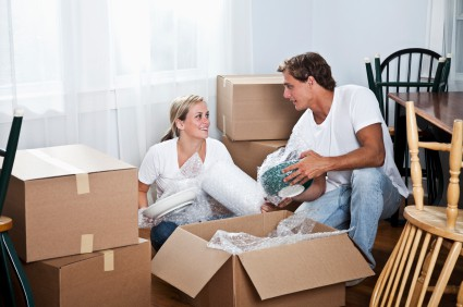 Couple unpacking household items