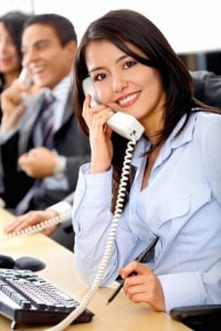 smiling professional lady on telephone