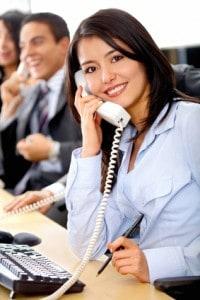 smiling professional lady on telephone